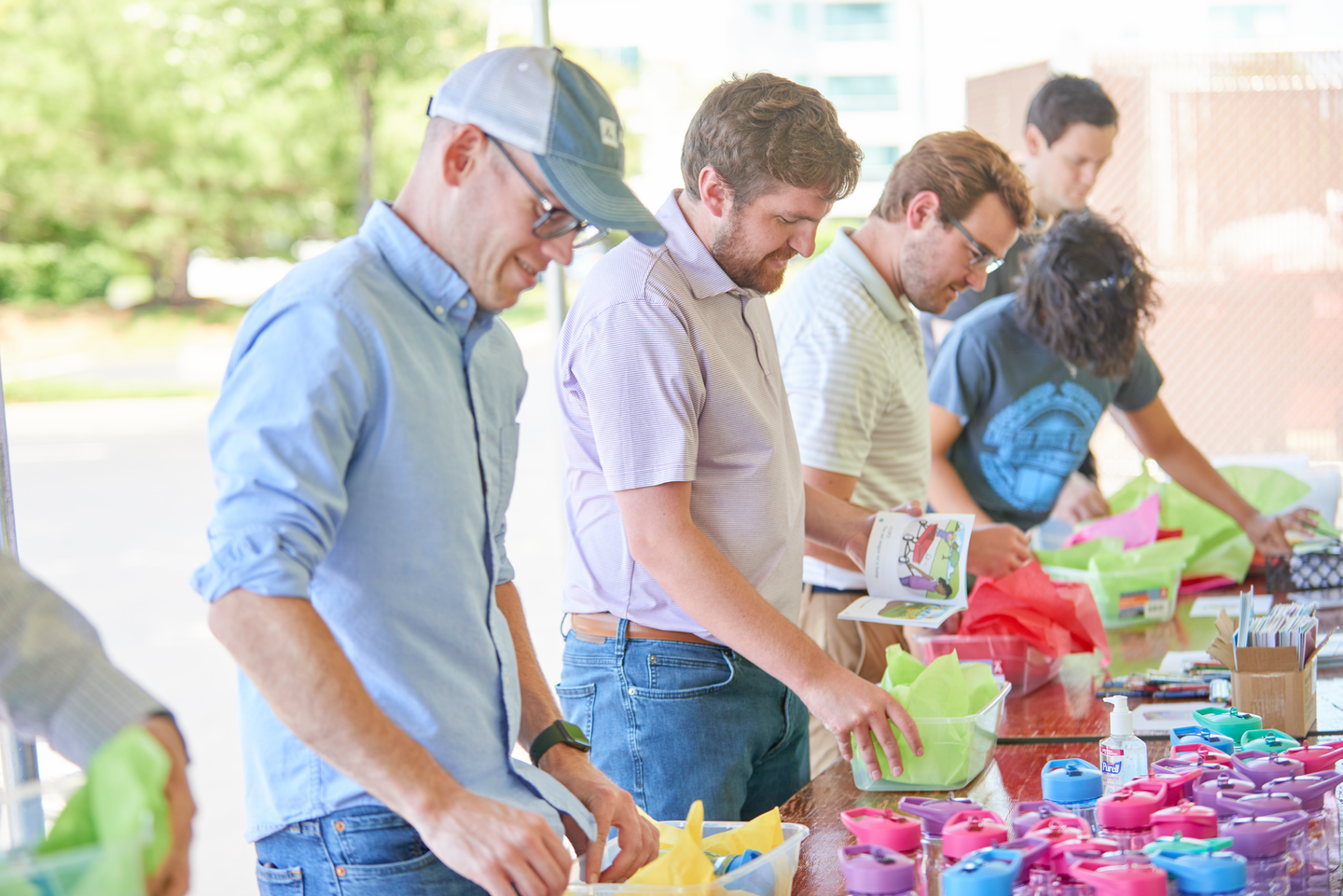 AD Associates are assembling boxes full of toys, coloring books and other activities at one of the buying group's Giving Back event locations on June 16.